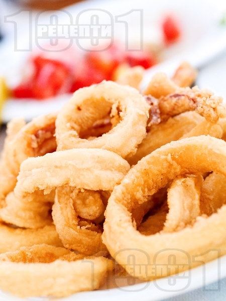 Пържени панирани калмари в яйца и брашно - снимка на рецептата